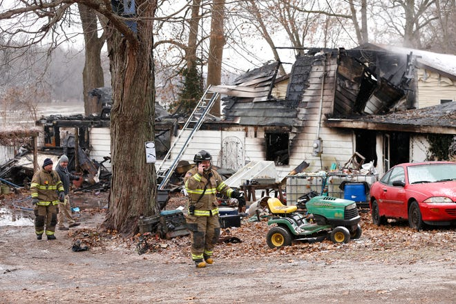 Firefighters remain on the scene following an early morning house fire that claimed several lives Wednesday, November 28, 2018, at 4317 Pottawatomie Road in Logansport.