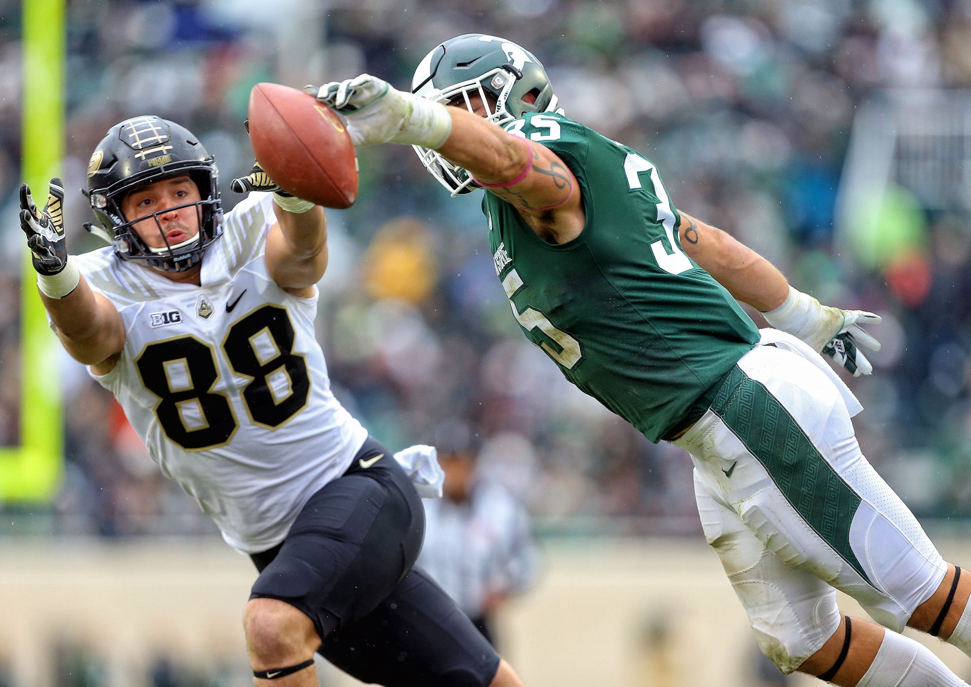 Michigan State Spartans linebacker Joe Bachie (35) knocks down pass intended for Purdue Boilermakers tight end Cole Herdman (88) during the first half of a game at Spartan Stadium on Oct. 27, 2018.