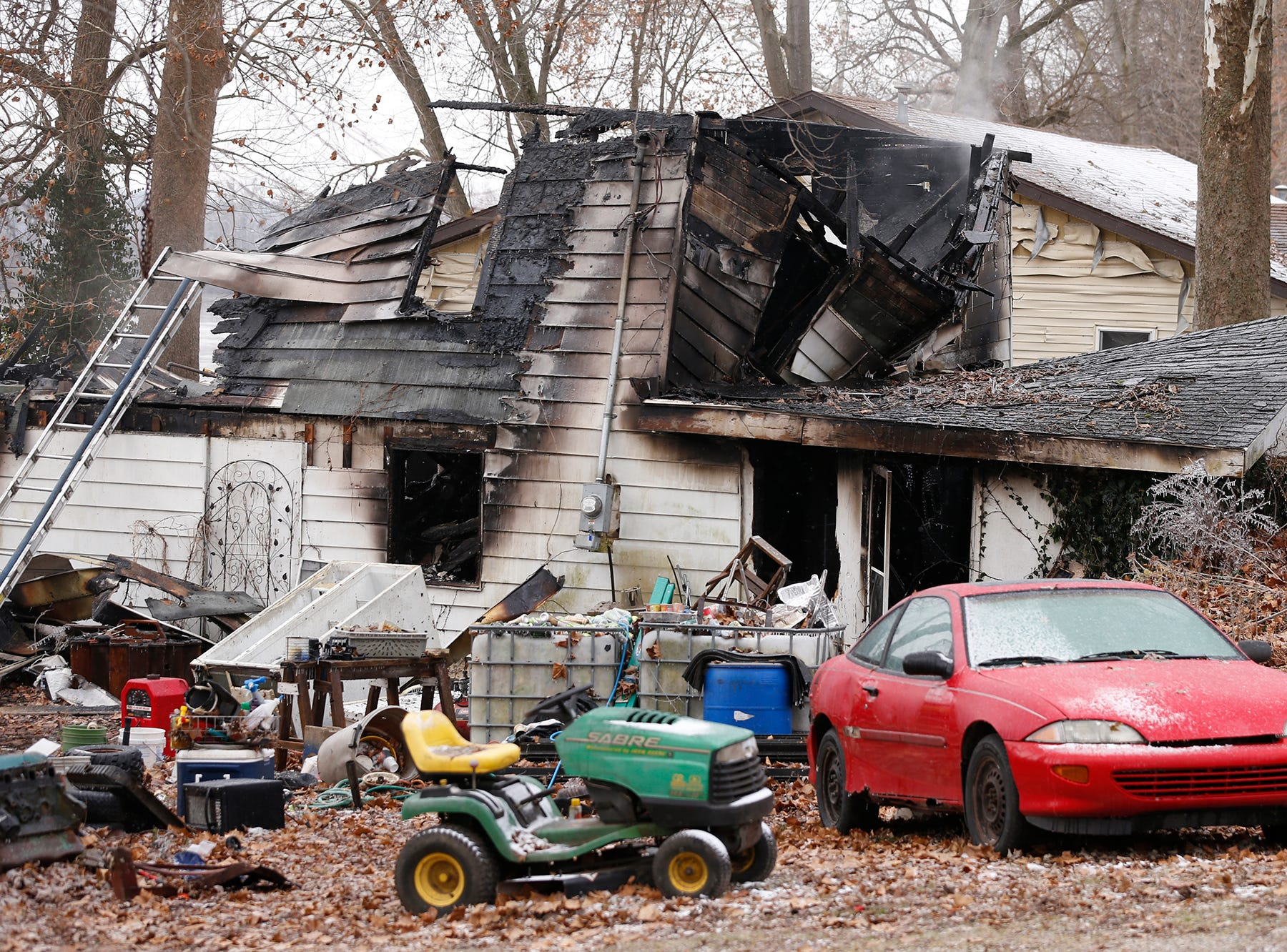 The charred structure following an early morning house fire that claimed several lives Wednesday, November 28, 2018, at 4317 Pottawatomie Road in Logansport.
