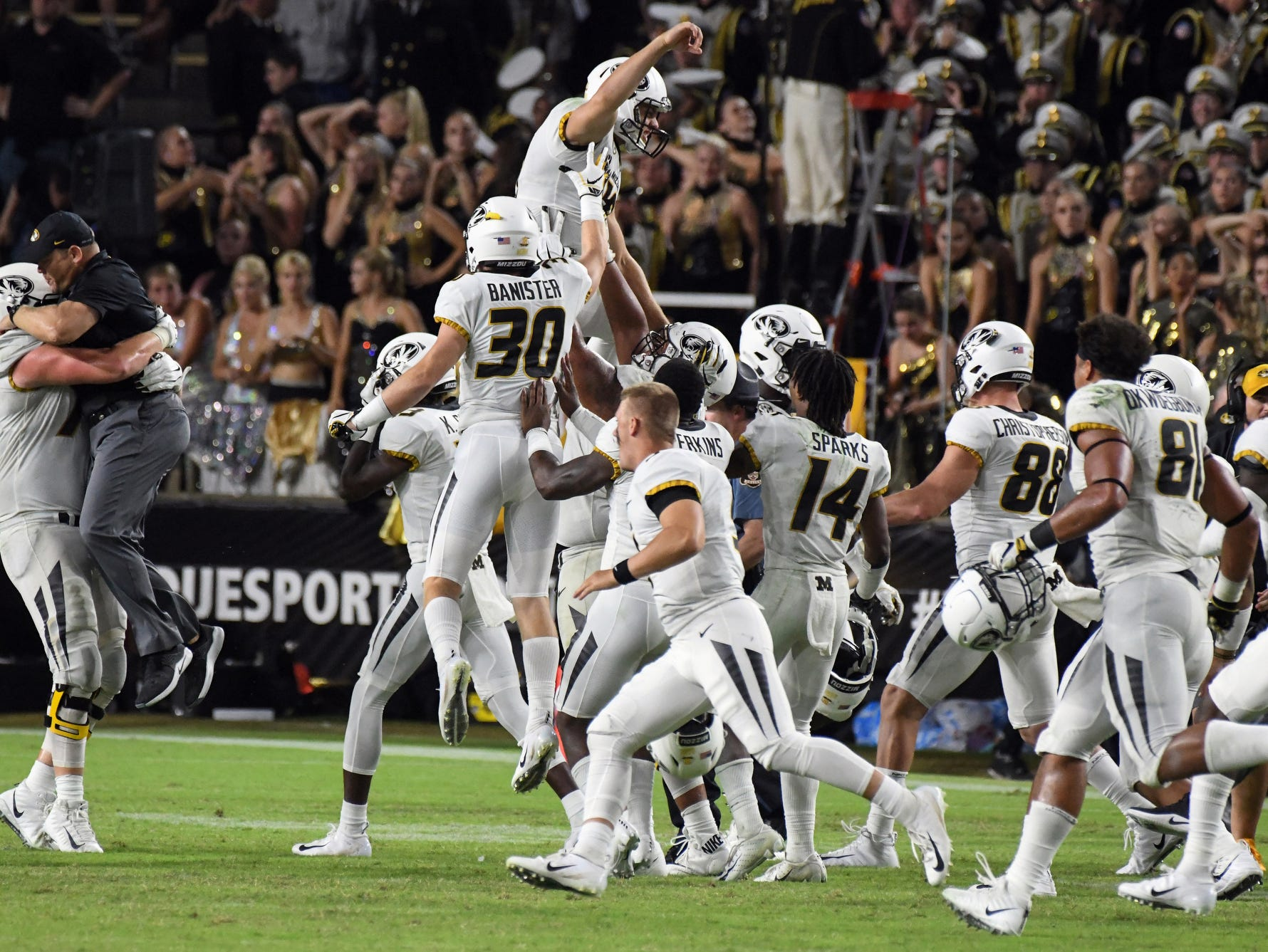 Missouri players celebrate after Tucker McCann's field as time expired lifted the Tigers to a 40-37 victory over Purdue Saturday, September 15, 2018, in West Lafayette.