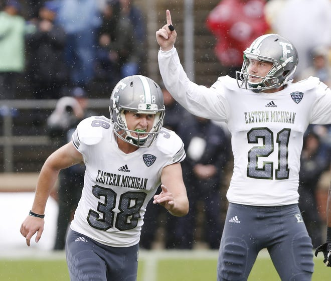 Eastern Michigan kicker Chad Ryland, left, reacts after his field goal as time ran out lifted the Eagles to a 20-19 victory over Purdue Saturday, September 8, 2018, in West Lafayette.