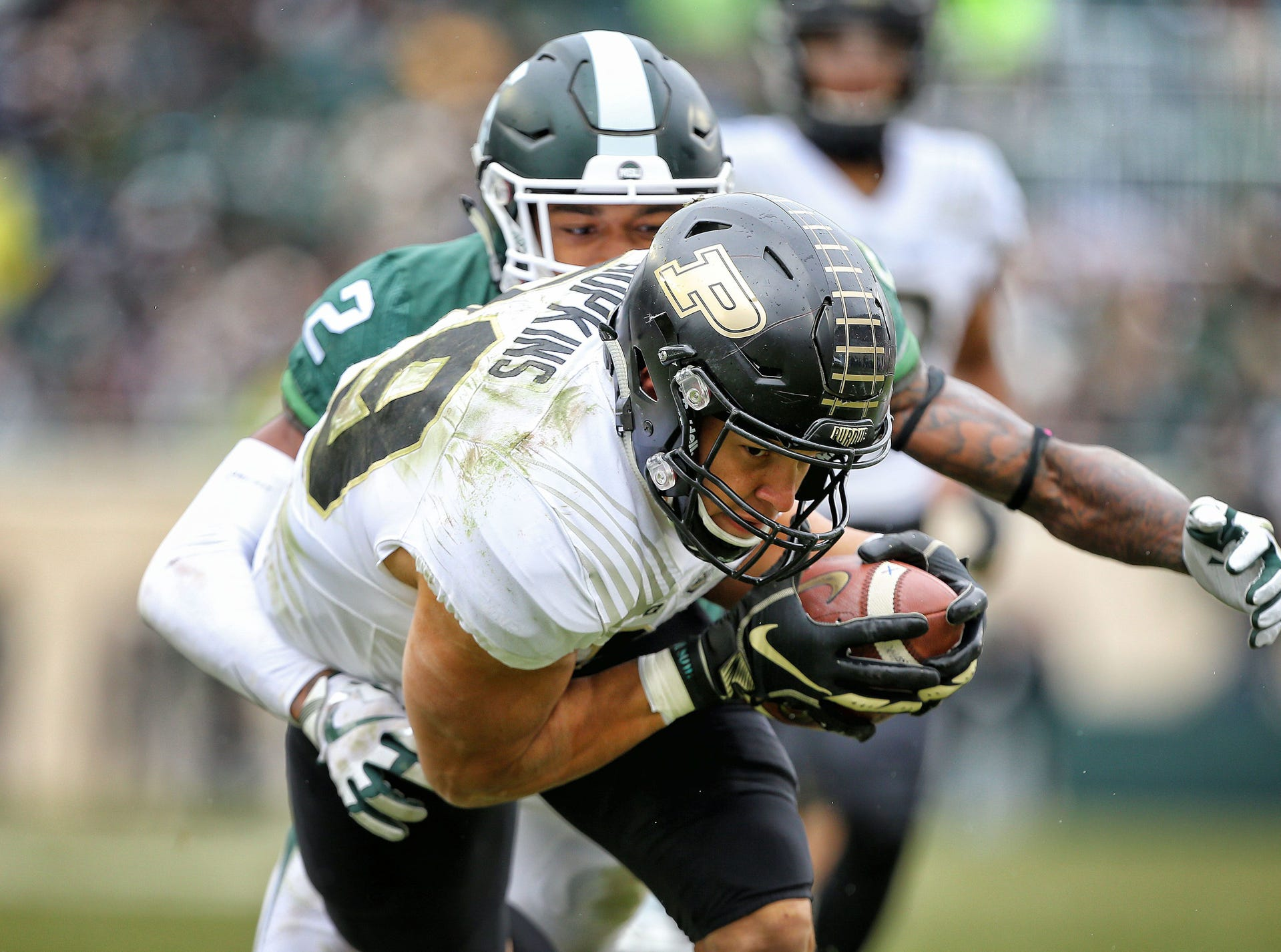 Purdue Boilermakers tight end Brycen Hopkins (89) runs for yards after a catch against Michigan State Spartans cornerback Justin Layne (2) during the second half at Spartan Stadium.