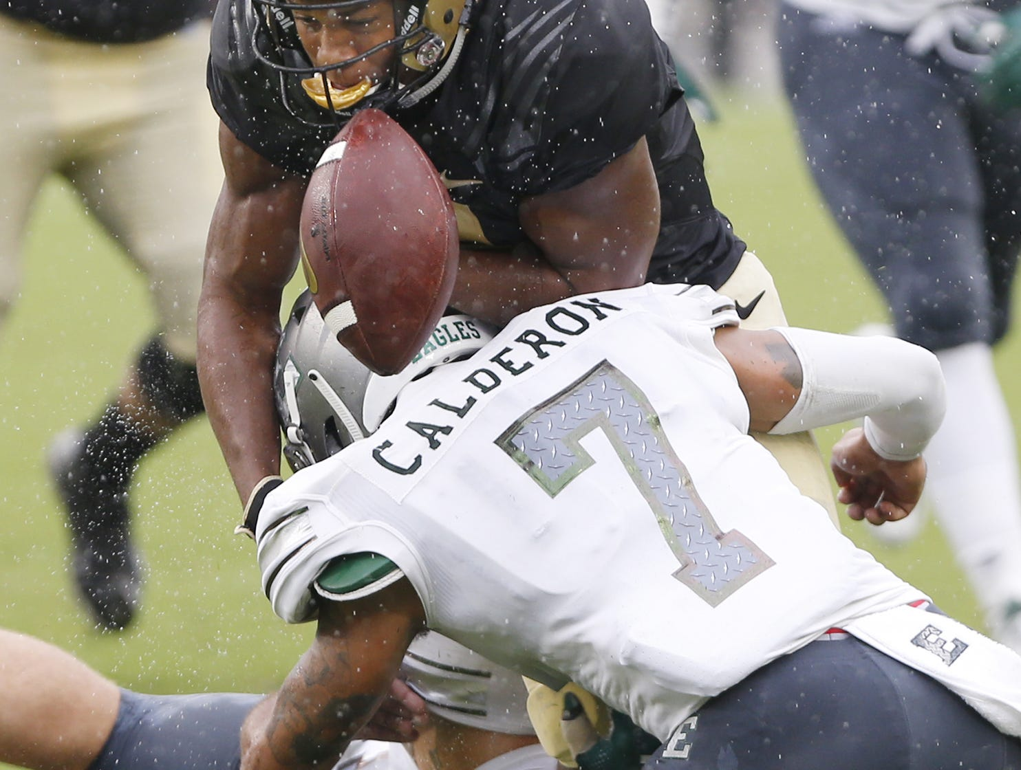 Rondale Moore of Purdue fumbles the ball as he is hit by Ikie Calderon of Eastern Michigan in the first half Saturday, September 8, 2018, in West Lafayette. Purdue fell to Eastern Michigan 20-19.