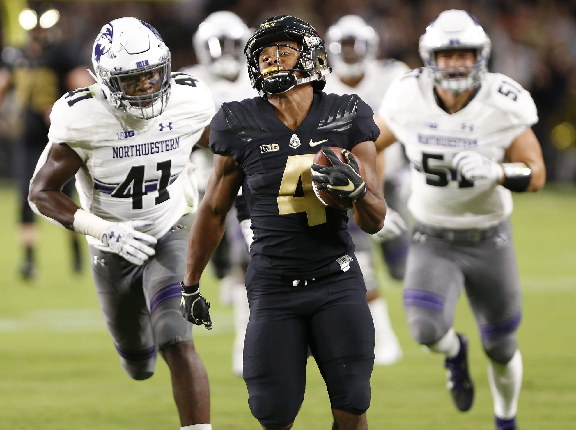 Rondale Moore of Purdue on a 76-yard touchdown run at 1:02 in the first quarter against Northwestern Thursday, August 30, 2018, in West Lafayette. Moore's score tied the game at 14-14. Northwestern defeated Purdue 31-27.