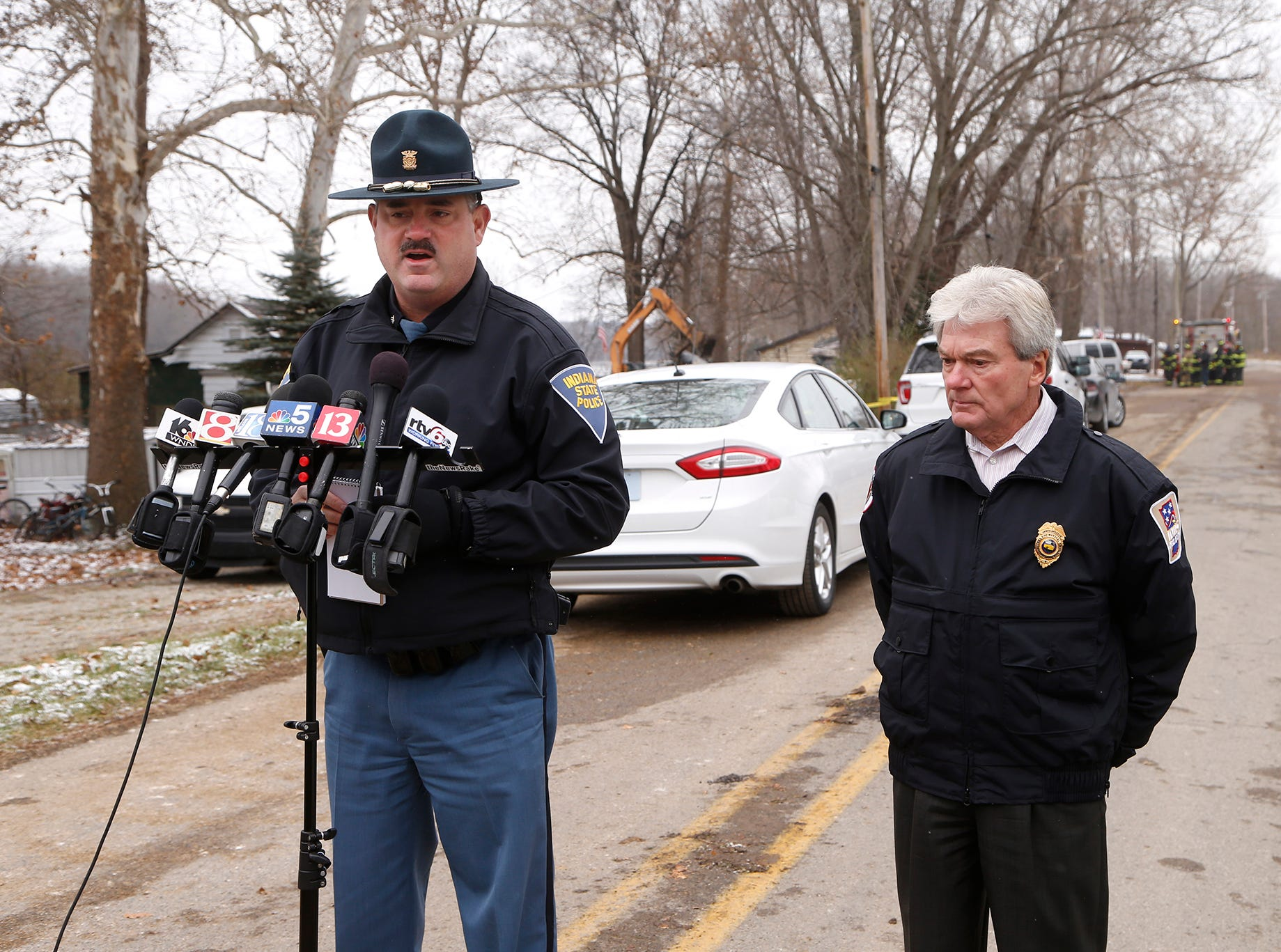Indiana State Police Sgt. Tony Slocum, left, and Indiana State Fire Marshall Jim Greeson address members of the media following an early morning fatal house fire Wednesday, November 28, 2018, at 4317 Pottawatomie Road in Logansport. Sgt. Slocum confirmed that two people got out of the house and were taken to Logansport Memorial Hospital. One body has been recovered from the house. Firefighters are still searching the home to see if there are additional fatalities. Sgt. Slocum said that until otherwise, the fire is being treated as a criminal investigation.