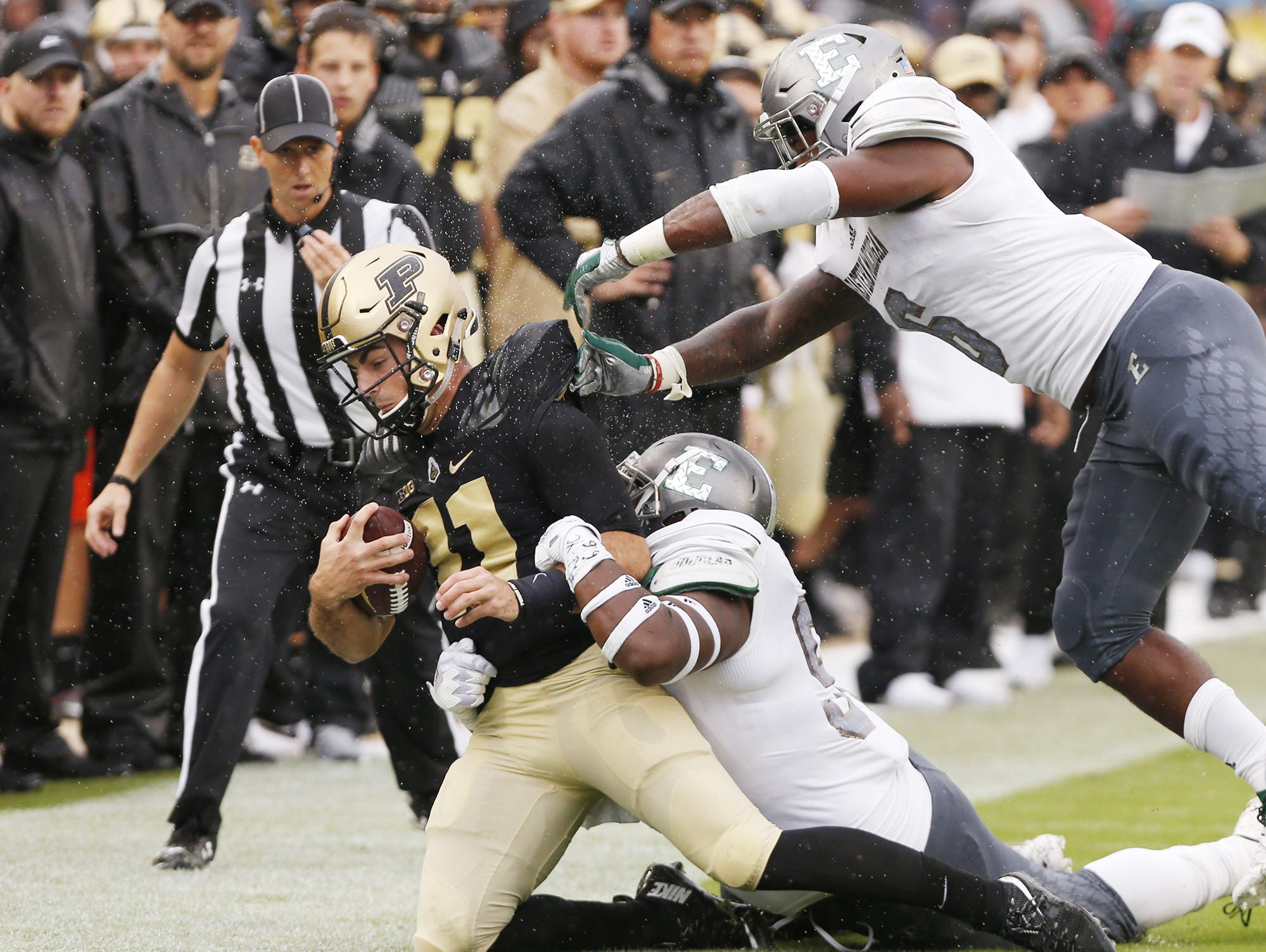 Purdue quarterback David Blough is brought down by the Eastern Michigan defense after a carry in the first half Saturday, September 8, 2018, in West Lafayette. Purdue fell to Eastern Michigan 20-19.