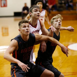 Clayton Burgh of Harrison battles Will Lasater of West Lafayette for position as the Red Devils shoot free throws in the Franciscan Health Hoops Classic Tuesday, November 27, 2018, at Lafayette Harrison defeated West Lafayette 73-56.