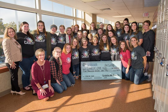 Members of the Fairfield Union Volleyball team and the FMC Foundation pose with a check donation to the hospital