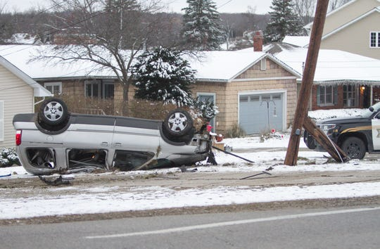 A Pontiac Montana van rolled over on the lawn of a residence on White Lake Road west of Carmer Road in Tyrone Township Wednesday, Nov. 28, 2018, leaving a trail of car parts and mailboxes knocked over in its path through several yards.