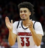 Louisville's Jordan Nwora celebrates as the clock ticks down on the game against Michigan State. Nov. 27, 2018