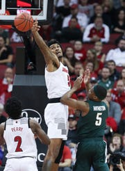 Louisville's Malik Williams (5) blocked a shot by Michigan State's Cassius Winston (5) during their game at the Yum Center.   Nov. 27, 2018