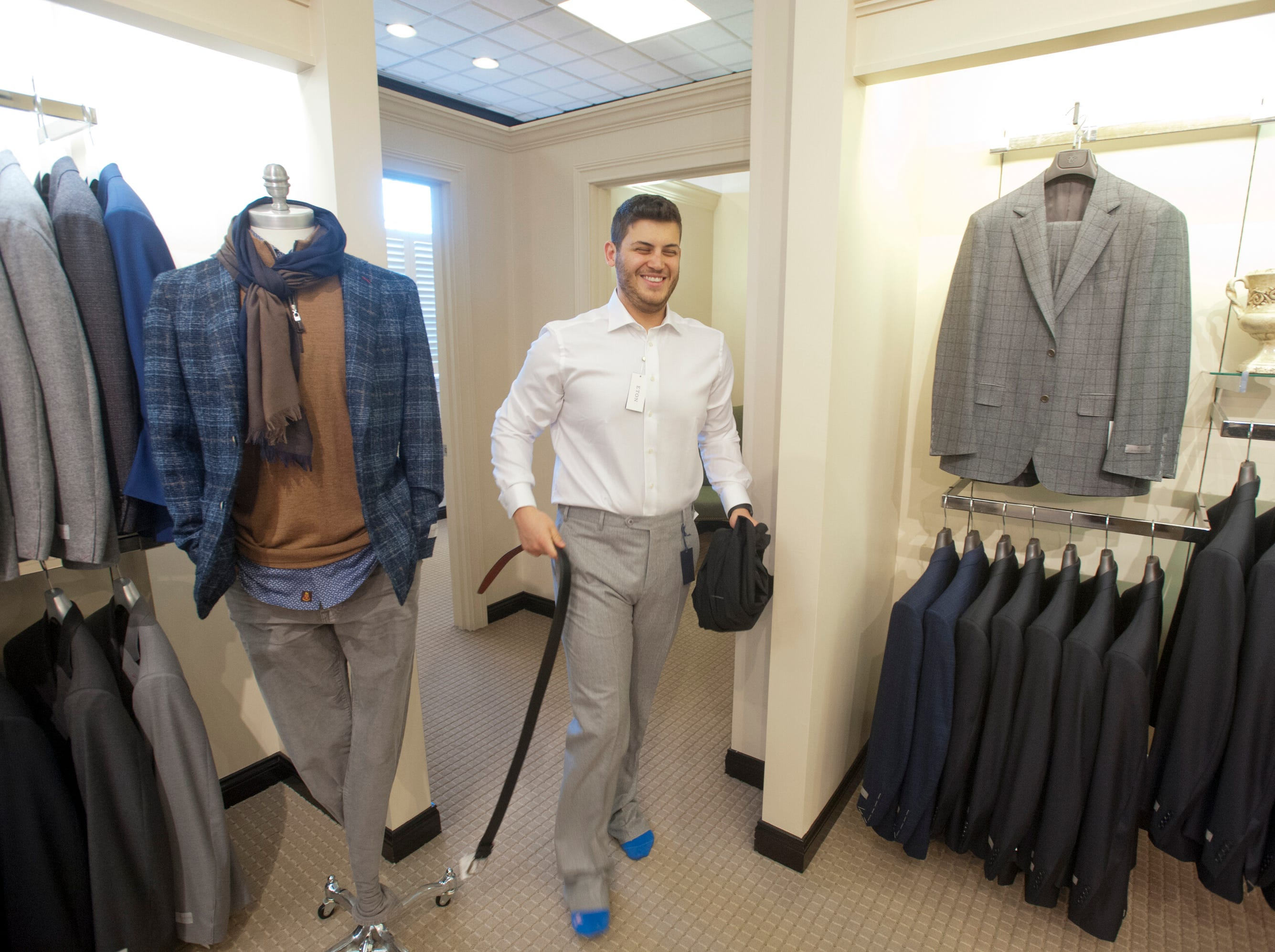 Morgan Davis of Sydney, Australia emerges from the dressing room at the Rodes Store on Brownsboro Road. Davis was in the store buying clothing for his upcoming wedding on December 29th.