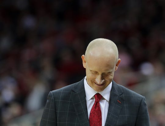 Louisville's Chris Mack smiles from the sideline. 