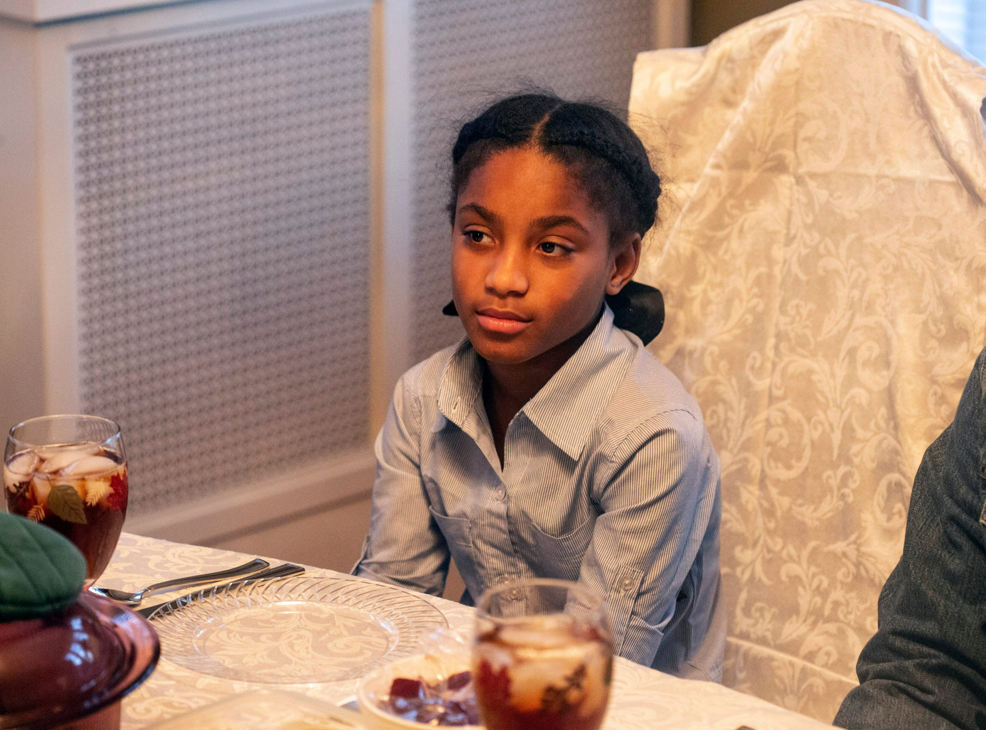 Malay Gaither, the Reverend Kevin Cosby's 10-year-old granddaughter, sits next to him during a Saturday family dinner. 11/24/18