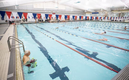 As Lakeside Swim Team practices, one man uses a far lane to exercise recently in November at the Mary T. Meagher Aqautic Center in Crescent Hill . The pool is used heavily throughout the year. The center traces its history back to 1954, when the popular pool relocated to the current site on Reservoir Avenue. A bubble was added in 1980 before the city parks department took it over in 1998.