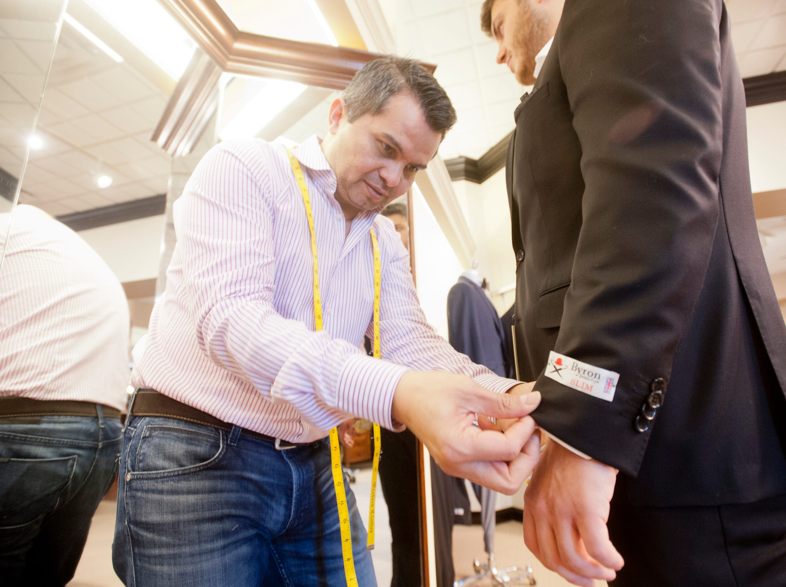 Rodes store tailor David Amaya fits Morgan Davis, of Sydney, Australia, for a suit.28 November 2018