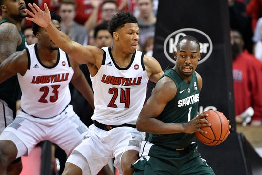 Michigan State guard Joshua Langford posts up Louisville forward Dwayne Sutton during the second half Tuesday night in Louisville.