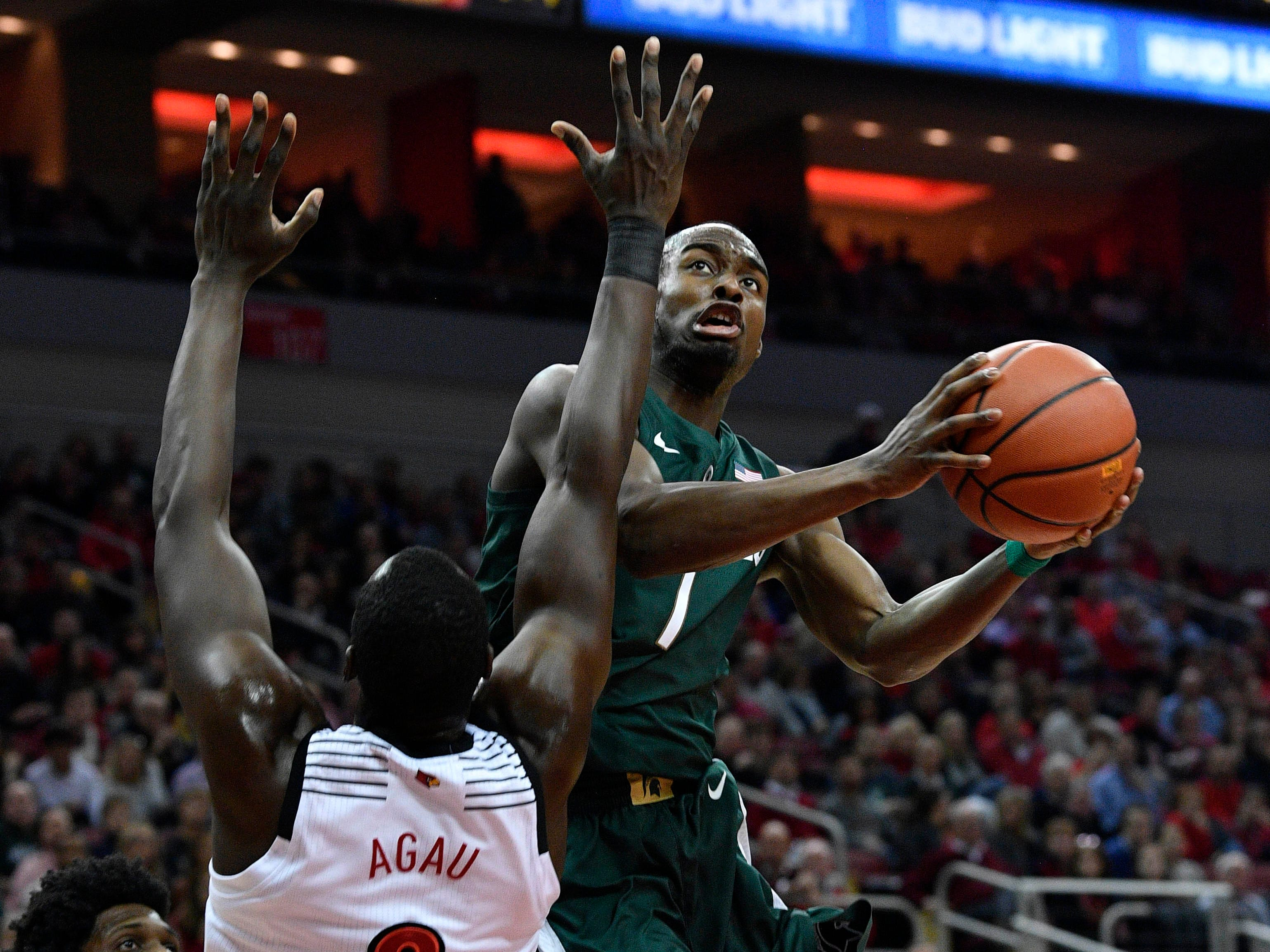 Michigan State Spartans guard Joshua Langford (1) shoots against Louisville Cardinals forward Akoy Agau (0) during the first half at KFC Yum! Center.