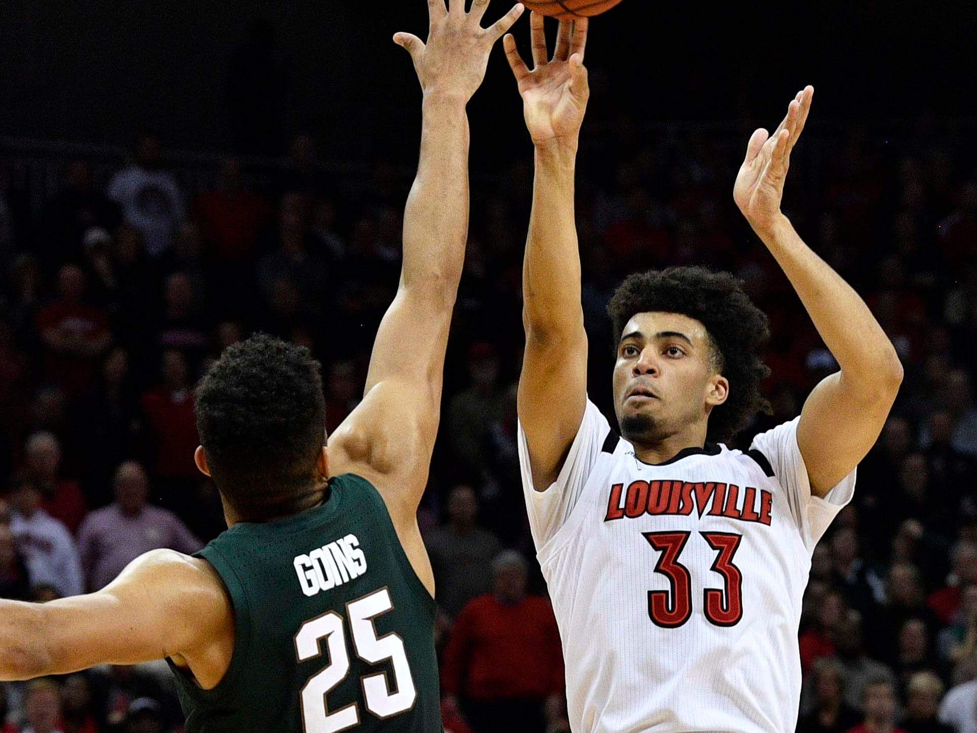 Louisville Cardinals forward Jordan Nwora (33) shoots against Michigan State Spartans forward Kenny Goins (25) during overtime at KFC Yum! Center. Louisville defeated Michigan State 82-78.