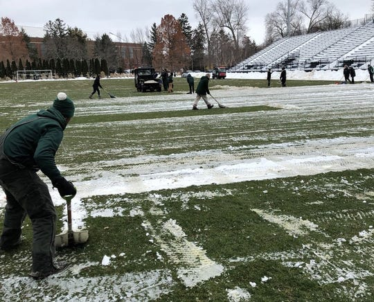 Crews at MSU have been working hard this week to remove ice and snow from DeMartin Stadium's natural grass field.