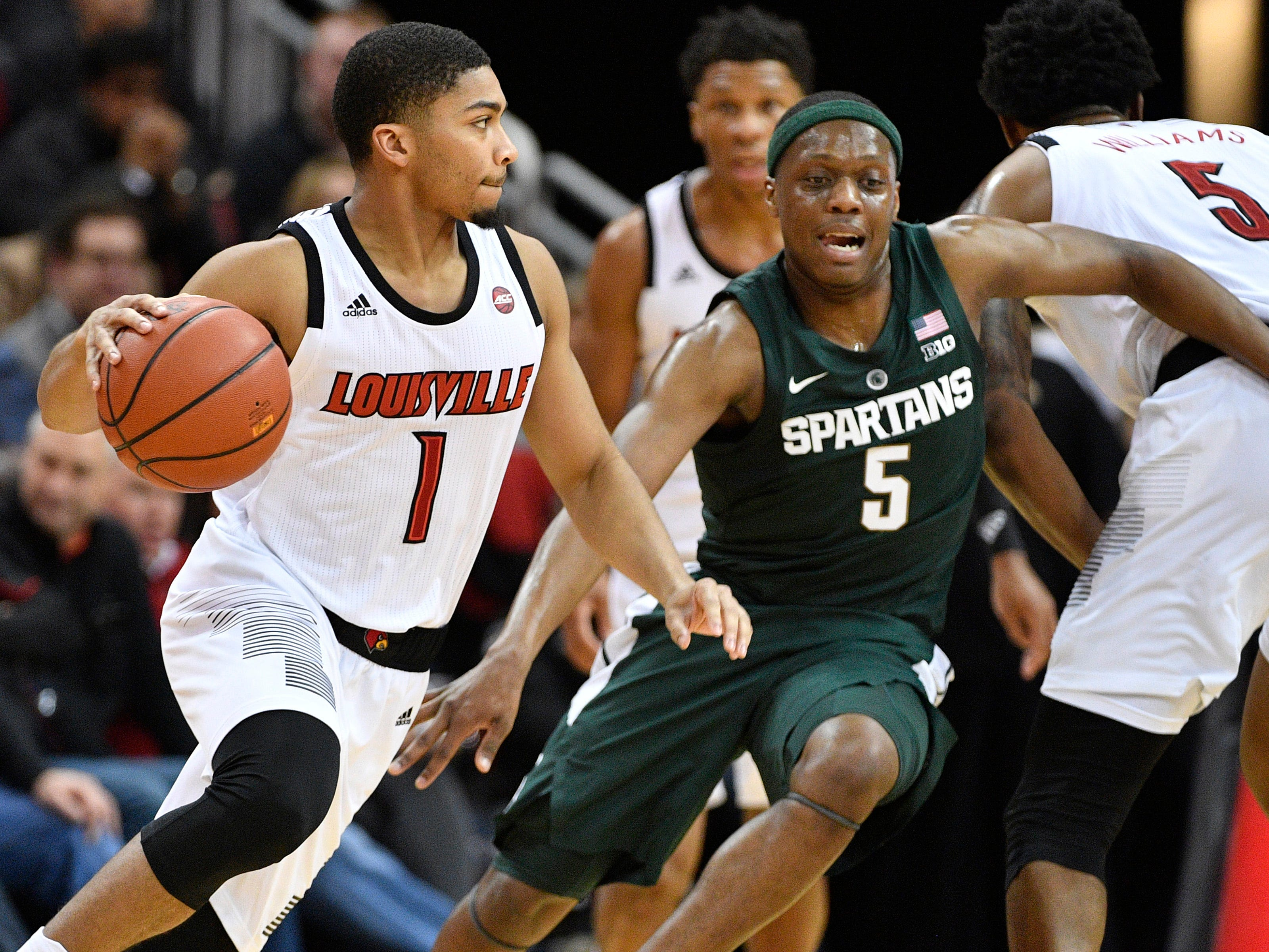 Louisville Cardinals guard Christen Cunningham (1) dribbles against Michigan State Spartans guard Cassius Winston (5) during the first half at KFC Yum! Center.