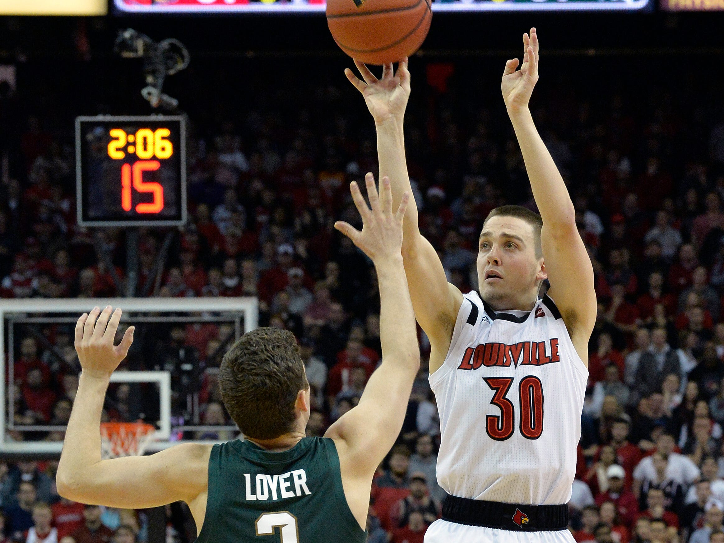 Louisville guard Ryan McMahon (30) attempts a three point shot over the defense of Michigan State guard Foster Loyer (3) during the second half of an NCAA college basketball game, in Louisville, Ky., Tuesday, Nov. 27, 2018. Louisville won 82-78.