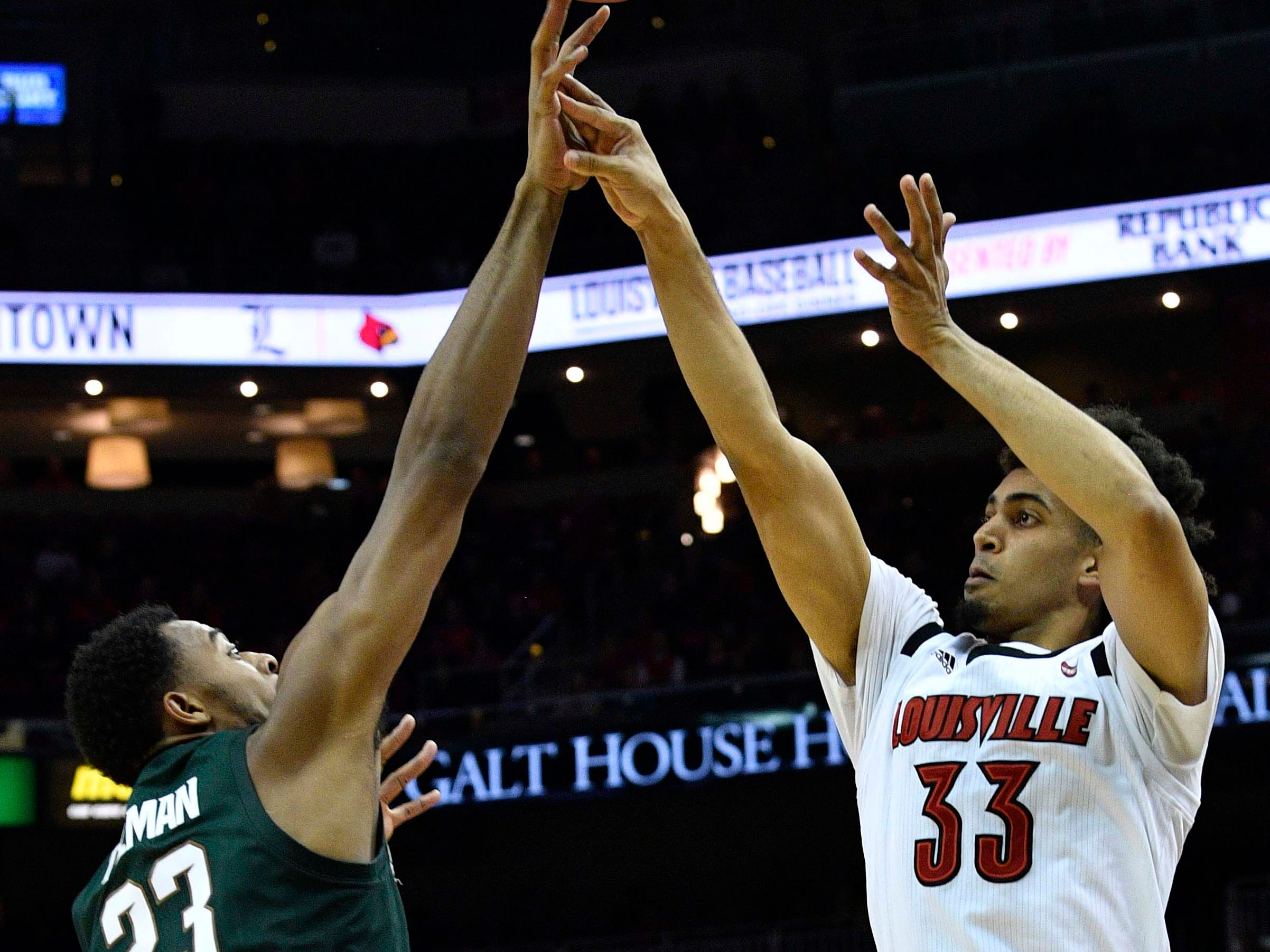 Michigan State Spartans forward Xavier Tillman (23) blocks the shot of Louisville Cardinals forward Jordan Nwora (33) during the second half at KFC Yum! Center. Louisville defeated Michigan State 82-78.