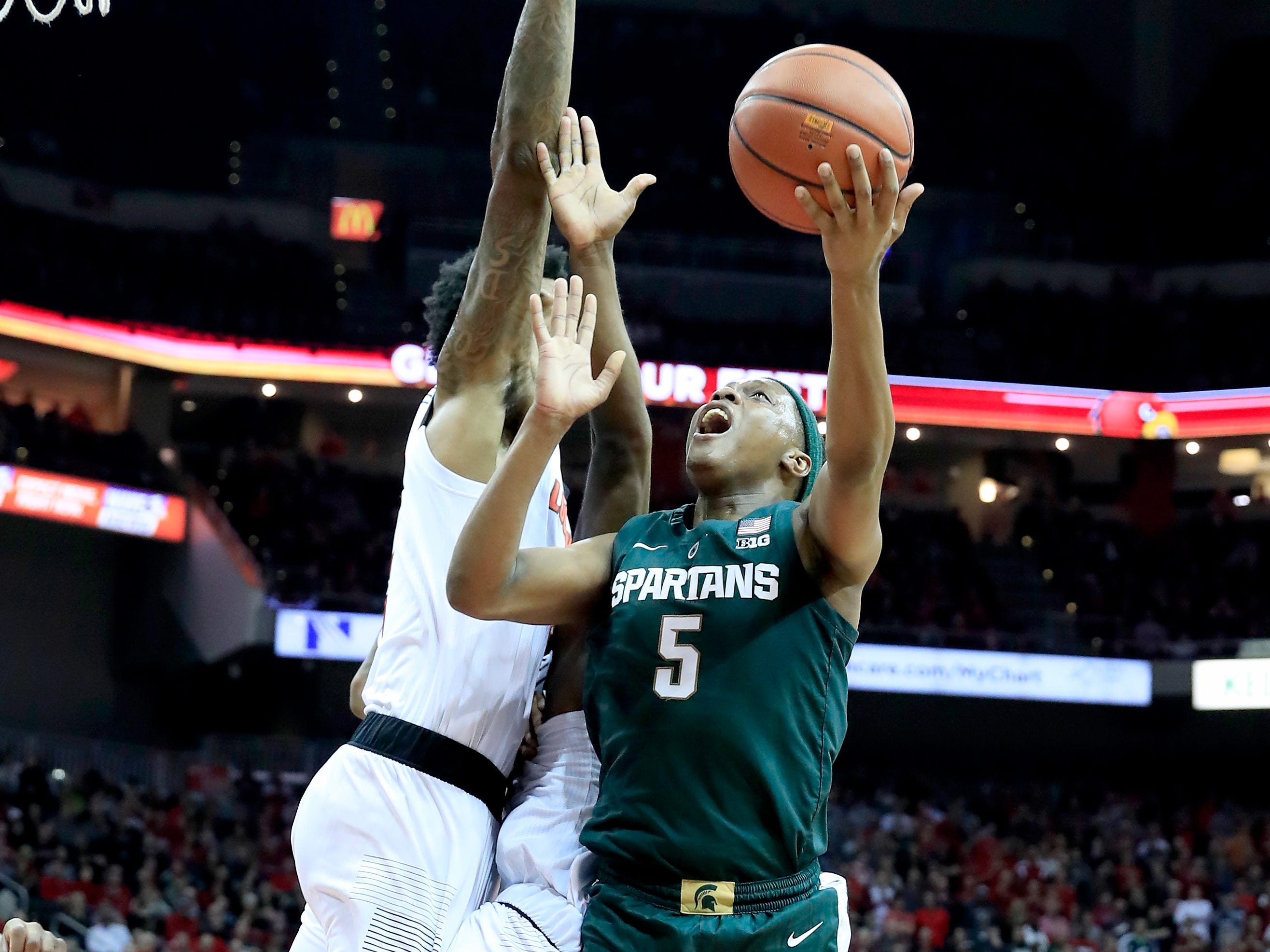 Cassius Winston #5 of the Michigan State Spartans shoots the ball against the Louisville Cardinals at KFC YUM! Center on November 27, 2018 in Louisville, Kentucky.