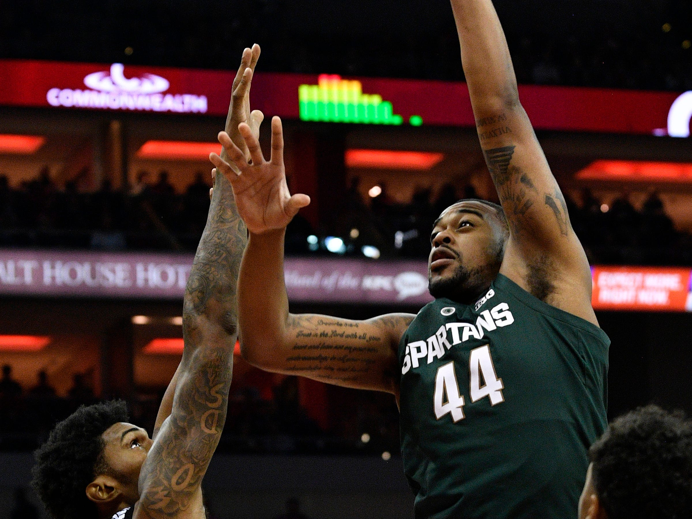 Michigan State Spartans forward Nick Ward (44) shoots against Louisville Cardinals center Malik Williams (5) during the first half at KFC Yum! Center.