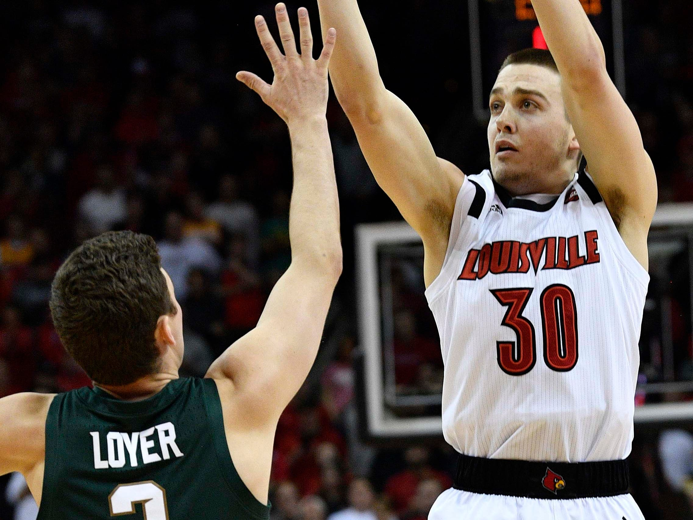 Louisville Cardinals guard Ryan McMahon (30) shoots against Michigan State Spartans guard Foster Loyer (3) during the second half at KFC Yum! Center. Louisville defeated Michigan State 82-78.