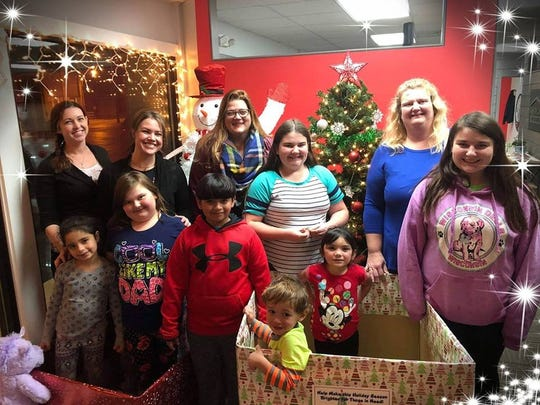 Theresa Collins (from left), Theresa Falvey, Amy Lundberg Moore, Karie Kobel and Karie's children are part of the Care 4 Kids collection.