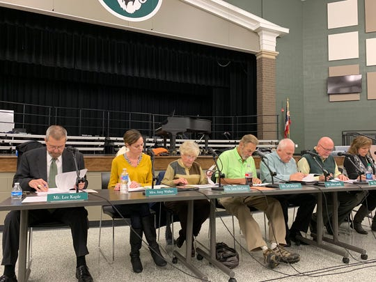 Acting superintendent Lee Kaple and members of the Madison school board meet on Tuesday at Madison Middle School.