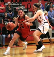 Lucas' Jessie Grover dribbles down the court in front of Crestview's Destiny Hargett on Tuesday evening.