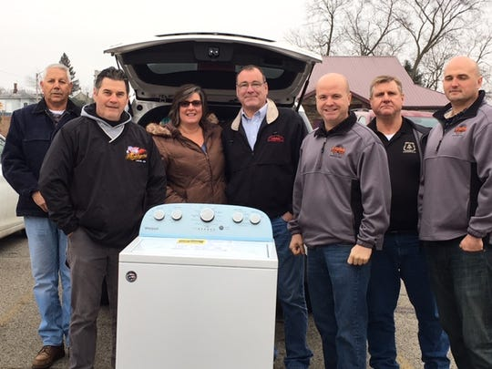 Members of the North Central Ohio Building and Construction Trades recently donated and delivered a new Whirlpool washing machine to Harmony House