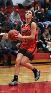 Lucas' Kayla Hignite attempts a jump shot while playing at Crestview earlier in the season.