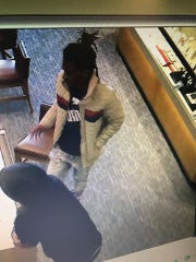 Local law enforcement believe these two men walked into a Kay Jewelers on Sunday, smashing a display case and making off with several pieces of jewelry. The picture captured from the store's surveillance camera was taken a few hours before the robbery.