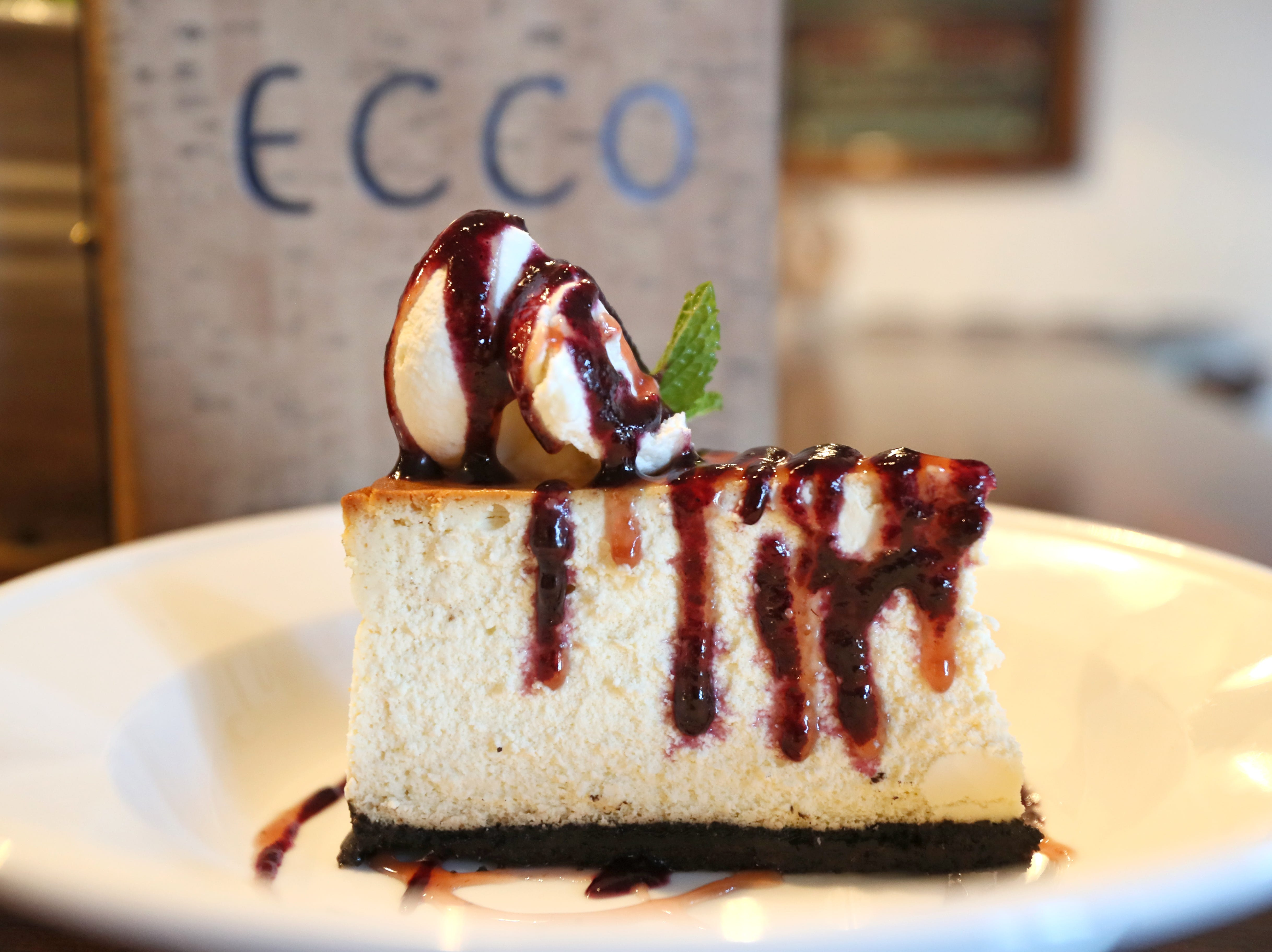 Cheesecake with blueberry and strawberry puree, whipped cream and mint sprigs at Ecco Restaurant in Midtown's Evergreen Historic District.