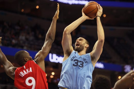 Memphis Grizzlies Marc Gasol makes a shot over Toronto Raptors defender Serge Ibaka during their game at the FedExForum on Tuesday, Nov. 27, 2018.