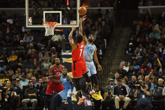 Mike Conley blocks a shot attempt by the Raptors' Kyle Lowry on Tuesday.