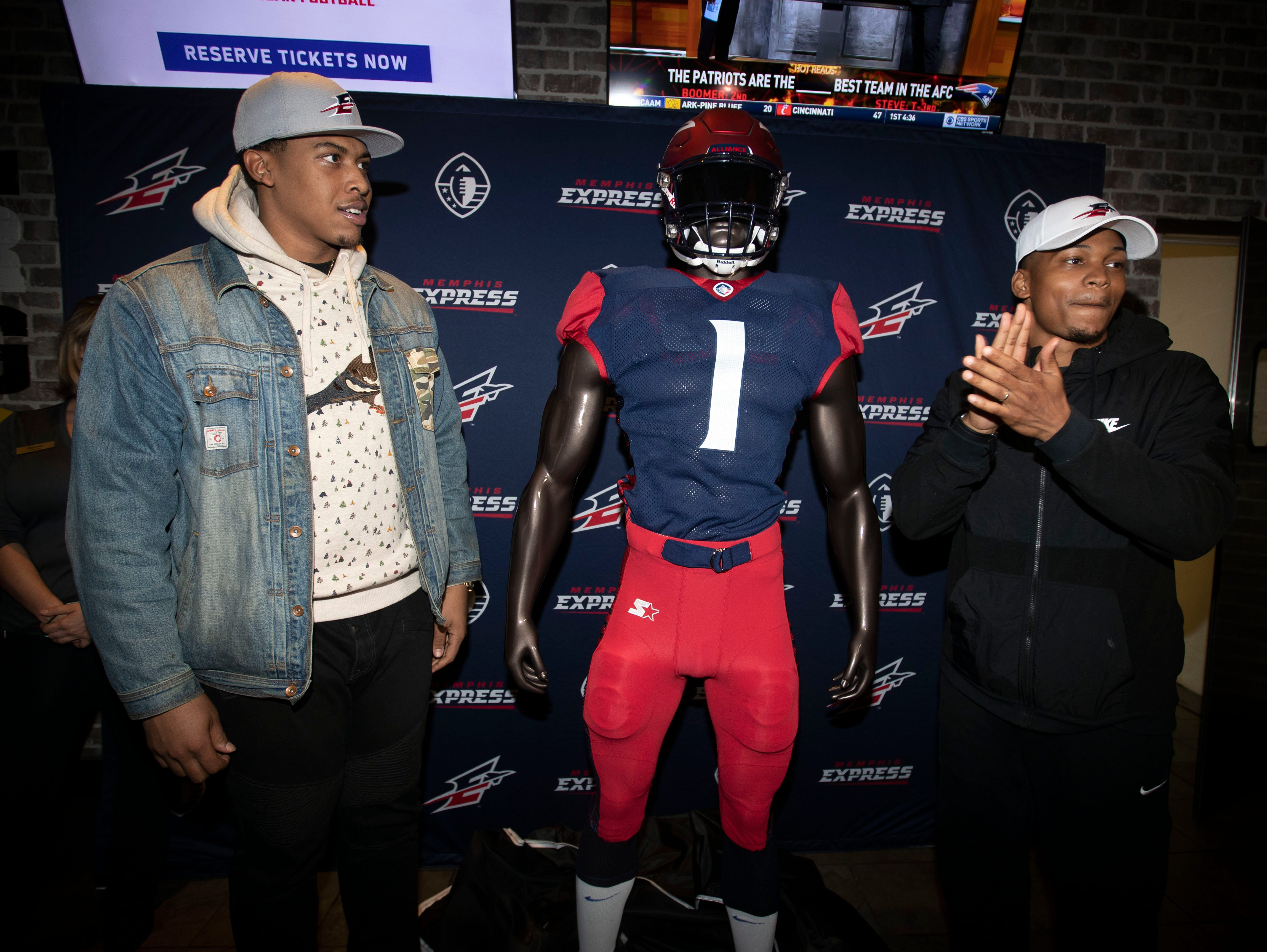 Memphis Express offensive lineman, Trevin Wallace and wide receiver Jonathan Ray unveil the teams new uniform during a watch party, Tuesday Nov. 27, 2018.