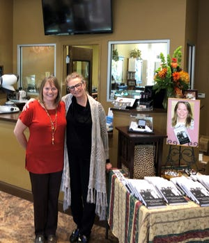 "Toni Lepeska, left, and Elizabeth Coplan spent part of Children's Grief Awareness Day on Nov. 15 at Master Jewelers in Olive Branch. They talked about their experiences and signed copies of ""Grief Dialogues: The Book."""