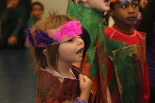 Early learner (pre-school student) Kairi Camandona enjoys performing before the soup was dished up.