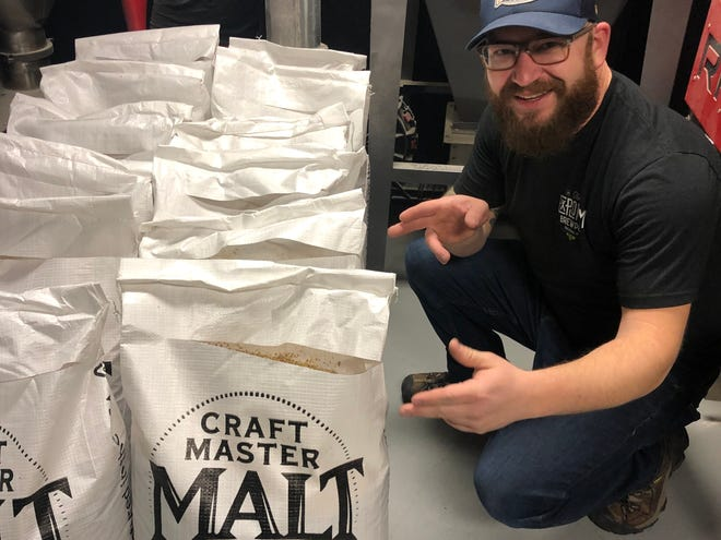 Kyle Ciske, head brewer at The Explorium Brewpub, gets malts together to brew Resilience, an India Pale Ale being brewed nationally to help victims of the California fires.