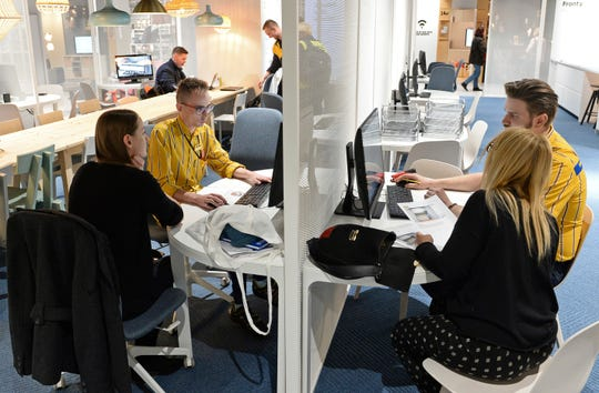 Ikea advisers help customers to arrange their interiors Thursday at a new Ikea store in Warsaw, Poland. The store, recently opened in a shopping mall, is part of a global strategy by the Swedish furniture chain to adapt to a changing consumer environment by opening small, accessible stores in city centers to complement the traditional large out-of-town store stores.