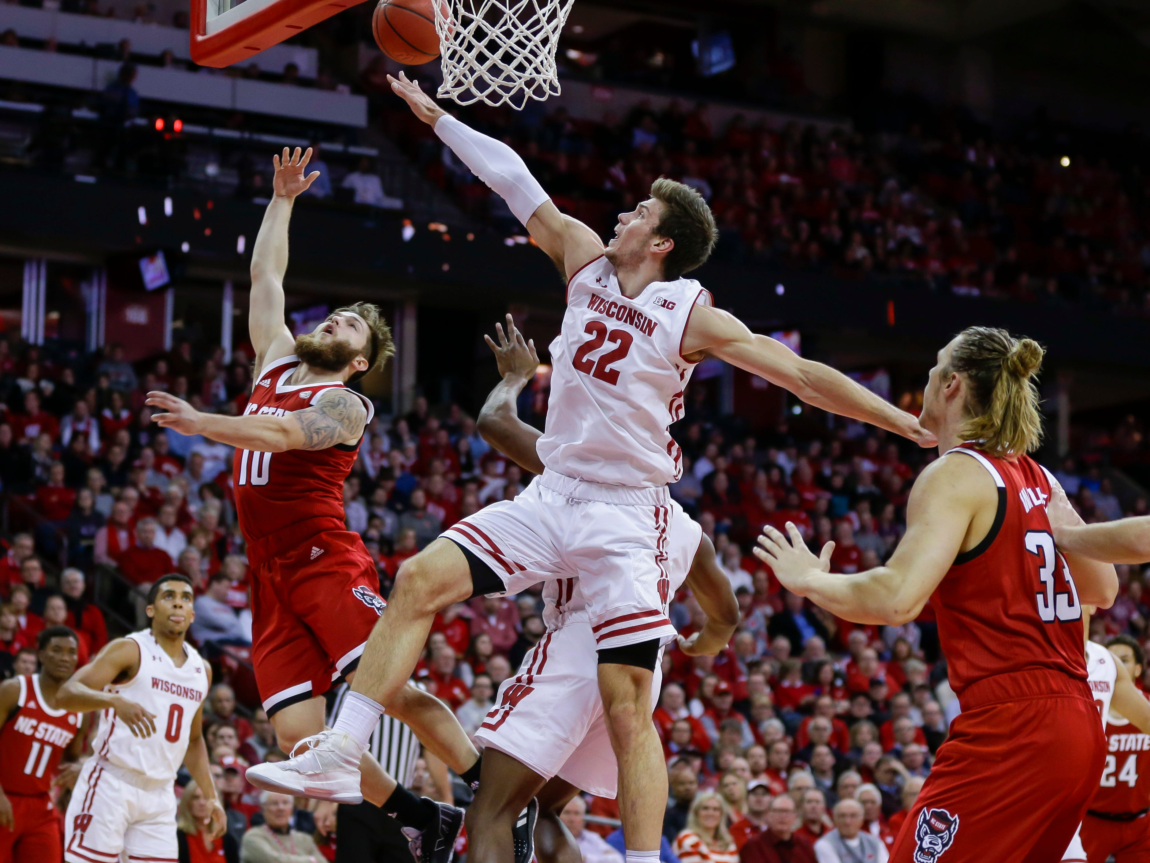 North Carolina State's Braxton Beverly tries to get a shot over Ethan Happ.