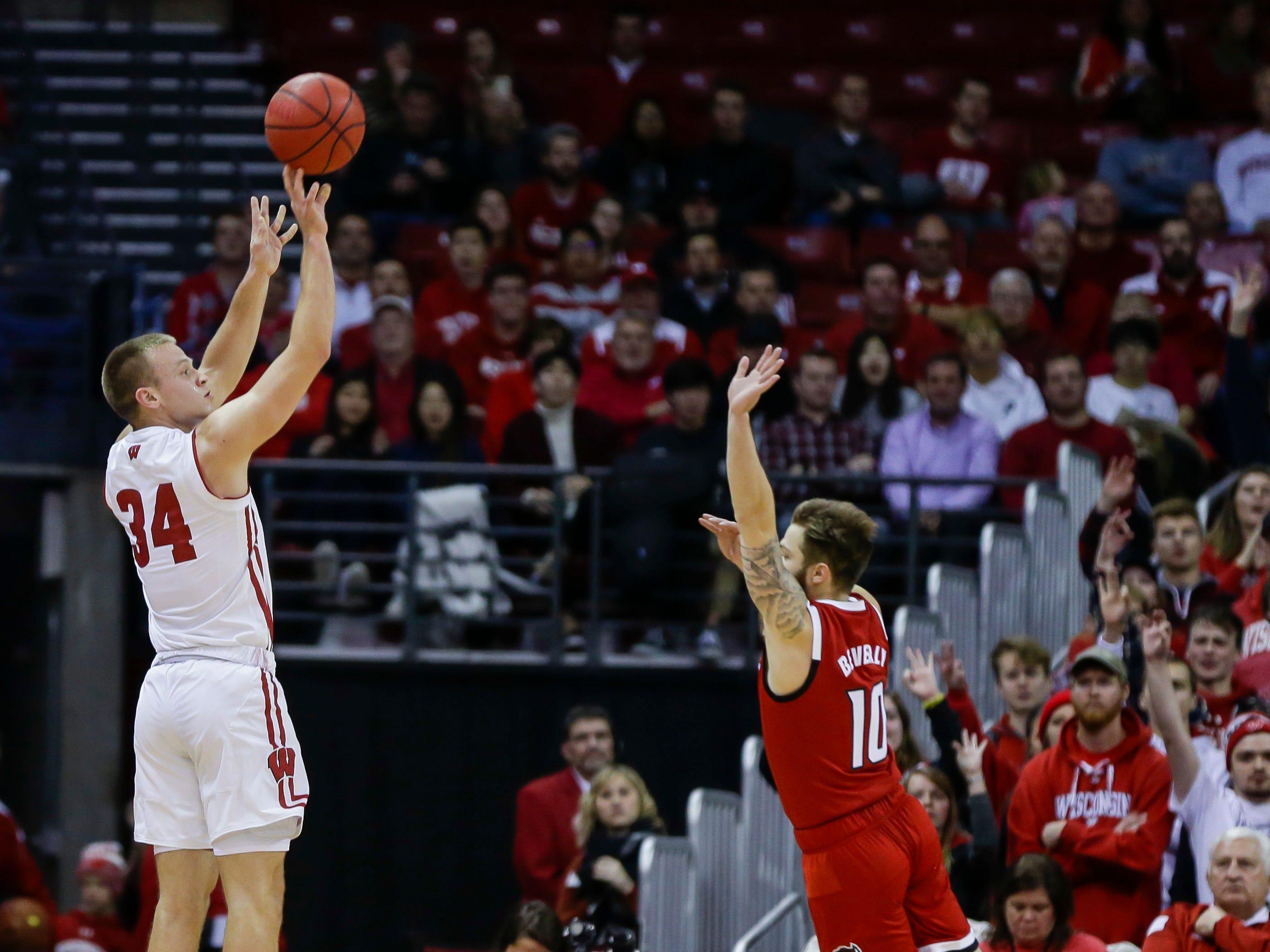 Wisconsin's Brad Davison shoots a three-pointer.