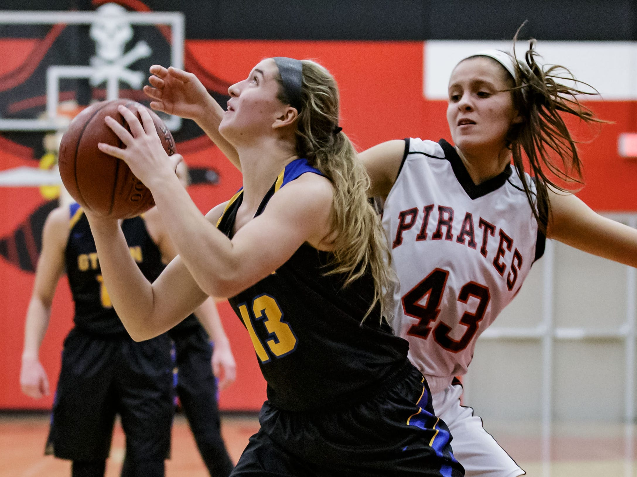Germantown sophomore Natalie Palzkill (13) battles past Pewaukee's Ellie Reyes (43) during the game at Pewaukee on Tuesday, Nov. 27, 2018.