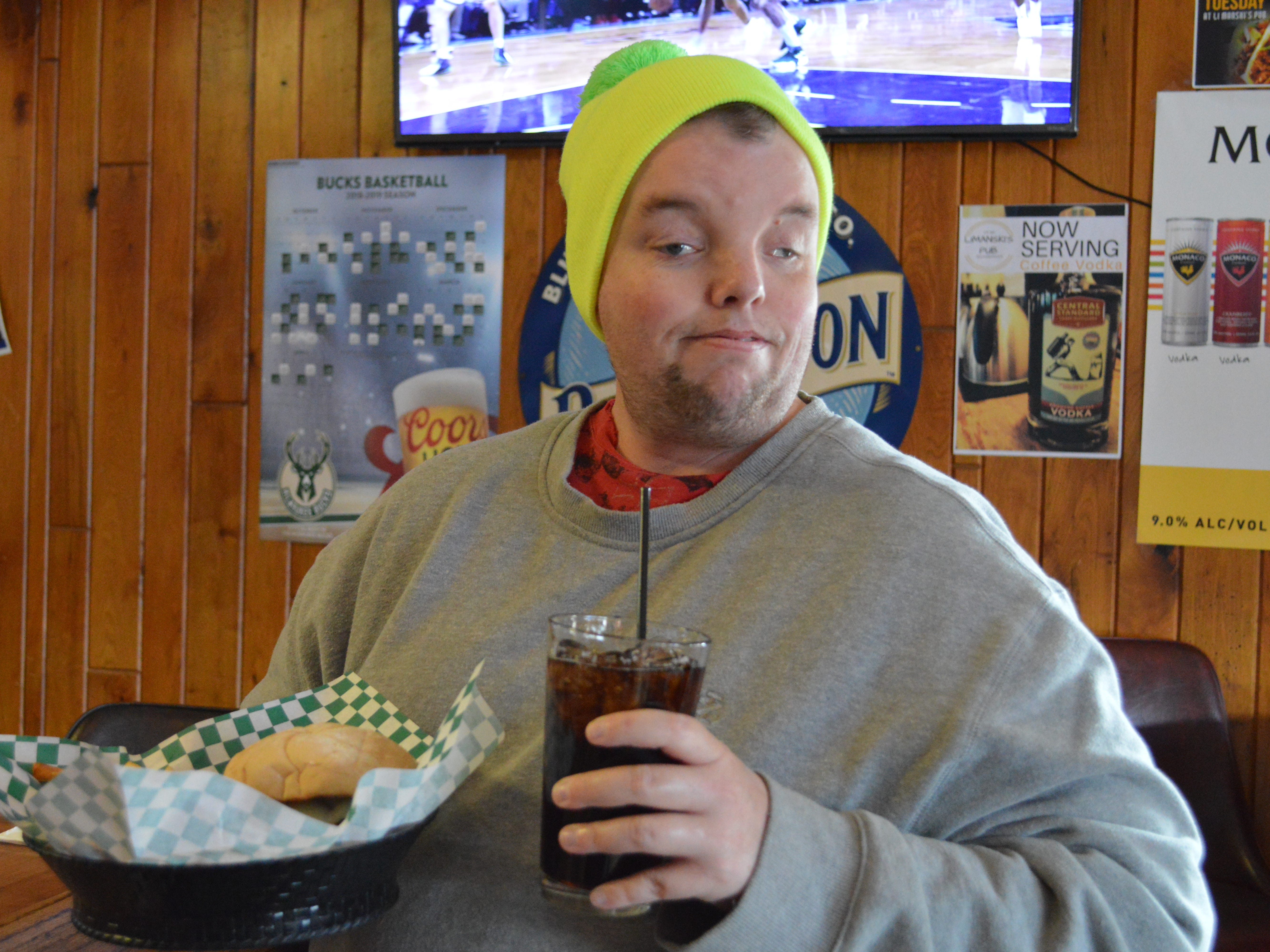 Customer Scott Dow of West Allis stops by the Limanski's Pub twice a week, and is a big fan of the cheeseburgers and staff.