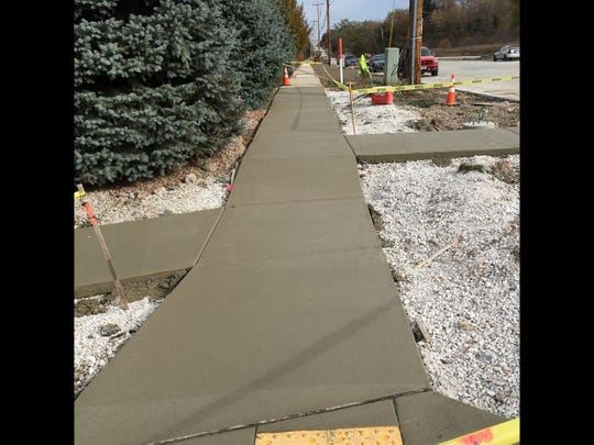 Newly poured concrete begins to cure in the autumn sunshine recently along the construction site of Northview Road. Work continues along the road from Grandview Boulevard to Tallgrass Circle more than two months later than expected.