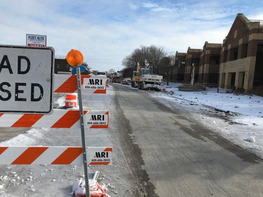 The pavement is in outside the West Allis Public Library (at right) but the big machinery still courses up and down National Avenue that will have to be finished next year.